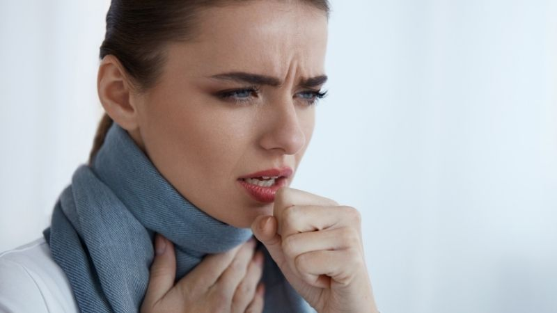 Woman coughing from dehumidifier